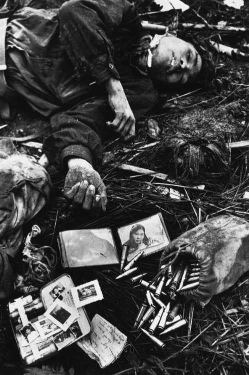 A North Vietnamese soldier lies dead amongst his possessions. The Battle of Hué, 1968. By Don McCullin.
